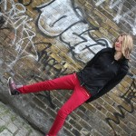 Blonde teen model in red jeans and black jacket