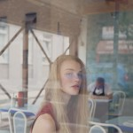 Pretty blonde model against graffiti background